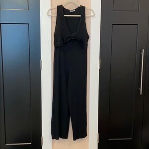 Black cotton jumpsuit with ruffle design